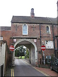 TQ1649 : Arched entrance to Victorian Housing Estate, Dorking by Richard Rogerson
