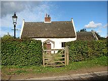 TG3311 : Foxley Cottage, Hemblington Corner by Evelyn Simak