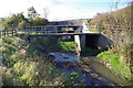 NZ2269 : Culvert and footbridge by peter maddison