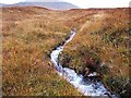 NM5034 : Stream on the NW slope of Ben More by wrobison