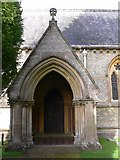 TQ1450 : The south door and porch of Ranmore church by Shazz
