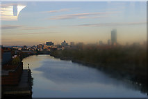 SJ8196 : Ship Canal and distant Manchester centre, from the tram by Christopher Hilton