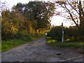 TM3564 : Footpath to Glemham Road & Deadman's Lane & entrance to Grove Farm by Adrian Cable