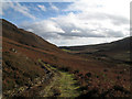 NN9734 : Estate road in Glen Shee by Trevor Littlewood