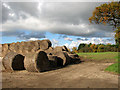 TM2086 : Old straw bales on hardstanding beside Poppy's Lane by Evelyn Simak