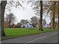 NY5264 : Village green and playground at Walton by Oliver Dixon