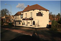 SK5984 : Low sun on the Blue bell Pub by roger geach