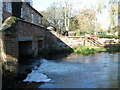 TF8930 : The River Wensum flowing under Sculthorpe Mill in Norfolk by Richard Humphrey