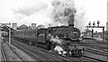 SP8633 : A local train for Banbury leaves Bletchley Station by Ben Brooksbank
