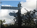 ST5957 : Signpost with ivy by Dr Duncan Pepper