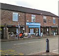 SJ9295 : Shops on Stockport Road by Gerald England