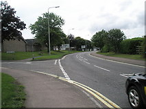 TM3877 : Approaching the junction of Lansbury Road with the A144 by Basher Eyre