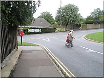 TM3877 : Postbox at the junction of Roman Way and the A144 by Basher Eyre