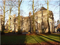 TL8564 : Bury St. Edmunds: the abbey ruins from across the churchyard by Chris Downer