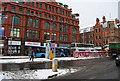 SJ8498 : Bus stops, Stevenson Square by N Chadwick