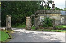 NZ1085 : Lodge and gate piers near Hartburn by Stephen Richards
