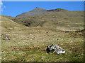 NM5034 : Boulder on grassy slope beside Abhainn Dhiseig by Trevor Littlewood