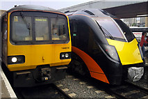 SE1632 : Spot the difference - old and new(ish) trains at Bradford Interchange by Phil Champion