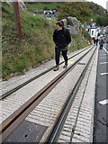 SH7782 : Walking up the tram tracks, Ty-Gwyn Road, Great Orme by Phil Champion