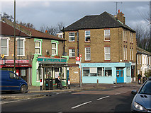 TQ4077 : Shops at the bottom of Westcombe Hill by Stephen Craven