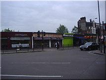 TQ2473 : Shops at junction of Replingham Road and Wimbledon Park Road by David Howard