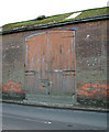 TM0587 : Old brick barn in Kenninghall Road, Banham - door by Evelyn Simak
