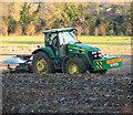 TM0588 : Ploughing a field by Clipbush Lane, Hunt's Corner by Evelyn Simak