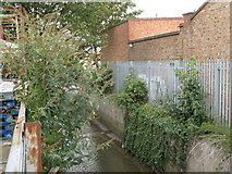 TQ3772 : The River Ravensbourne at the rear of Catford bus garage, Bromley Road, SE6 (2) by Mike Quinn