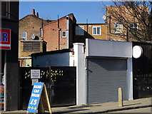 TQ3075 : Garage, Bedford Road, SW4 by Mike Quinn