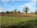 TG0336 : View along a field's edge south of Sharrington by Evelyn Simak