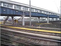 TQ2775 : Long footbridge at Clapham Junction station by Sandy B