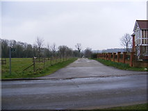 TM3864 : Footpath  to St.Peter's Church & entrance to Carlton Hall by Adrian Cable