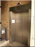 TQ3680 : Broken lift, Westferry Circus by Derek Harper