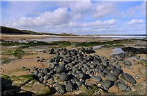 NU2422 : Rocks at south end of Embleton Bay by Andrew Curtis