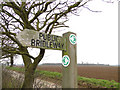 TG1835 : Public Bridleway sign and ploughed fields beyond by Adrian S Pye