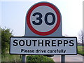 TG2436 : Southrepps sign by Adrian Cable