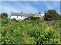 SV8708 : Old coastguard cottages and tower on St Agnes by Oliver Dixon