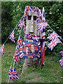 TL3762 : Wood sculpture ready for Royal Wedding Street Party by Julian Paren