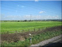 SJ4977 : Fields towards Grassy Lane from M56 by John Firth