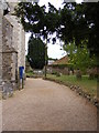 TM3055 : Footpath through All Saints Churchyard by Adrian Cable