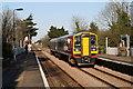 TG1100 : Train passing through Wymondham Station by Glen Denny