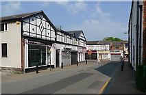 SJ8588 : Shops on Massey Street by Geoff Royle