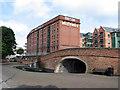 SK5739 : Canal bridge and British Waterways warehouse by John Sutton