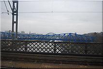 NZ2463 : Bridges over the River Tyne by N Chadwick