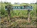 TG0626 : Reepham Road sign by Adrian Cable