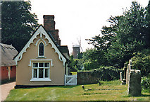 TL6030 : Thaxted: almshouses and windmill by John Sutton