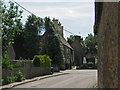 SP9780 : Lowick: Main Road by John Sutton