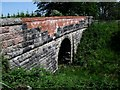 NS8071 : Road bridge over old railway by Robert Murray