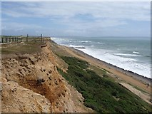 SZ2492 : Barton on Sea: cliffs and rough sea by Chris Downer