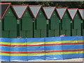 SZ1892 : Mudeford: six beach huts and a windbreak by Chris Downer